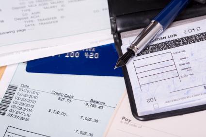 Various items reflecting on balancing a checkbook.