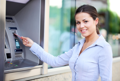 A woman at an ATM machine.