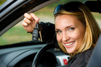 Woman showing keys to new car